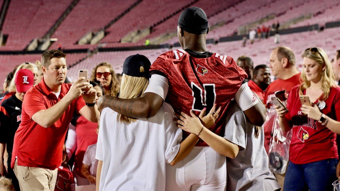 Jawon Pass poses for photos with fans after Friday's spring game. (WDRB photo by Eric Crawford)