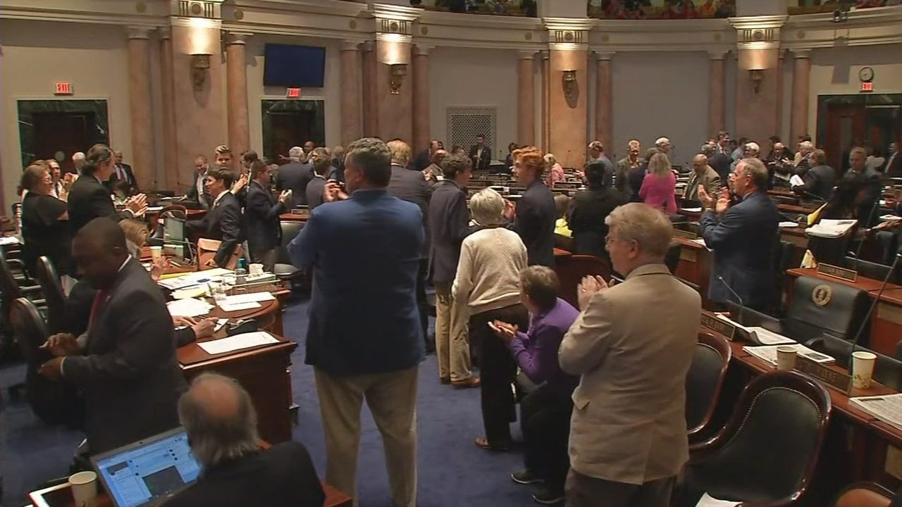 Lawmakers applauded as they adjourned the 2018 General Assembly session.