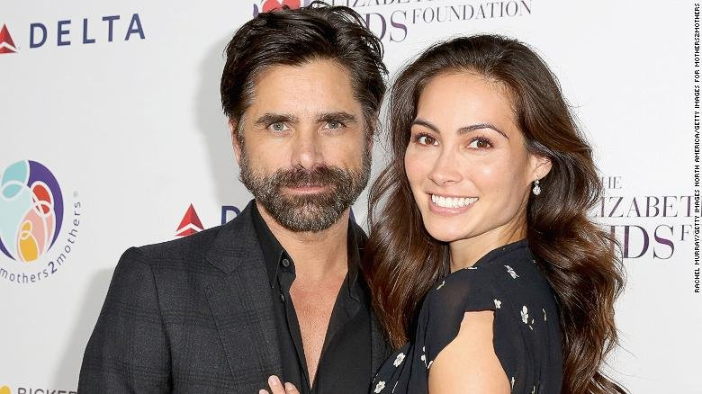 John Stamos and wife Caitlin welcome a son they named Billy.