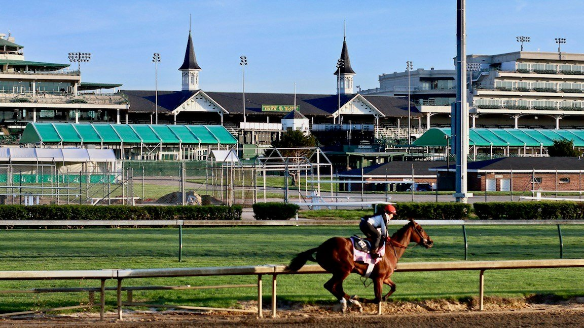 Coach Rocks, a filly trained by Dale Romans, breezes around the Churchill Downs track on Saturday morning in preparation for the Kentucky Oaks. (WDRB photo by Eric Crawford)