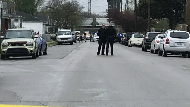 LMPD officers investigate after a robbery suspect was shot after exchanging gunfire with police.