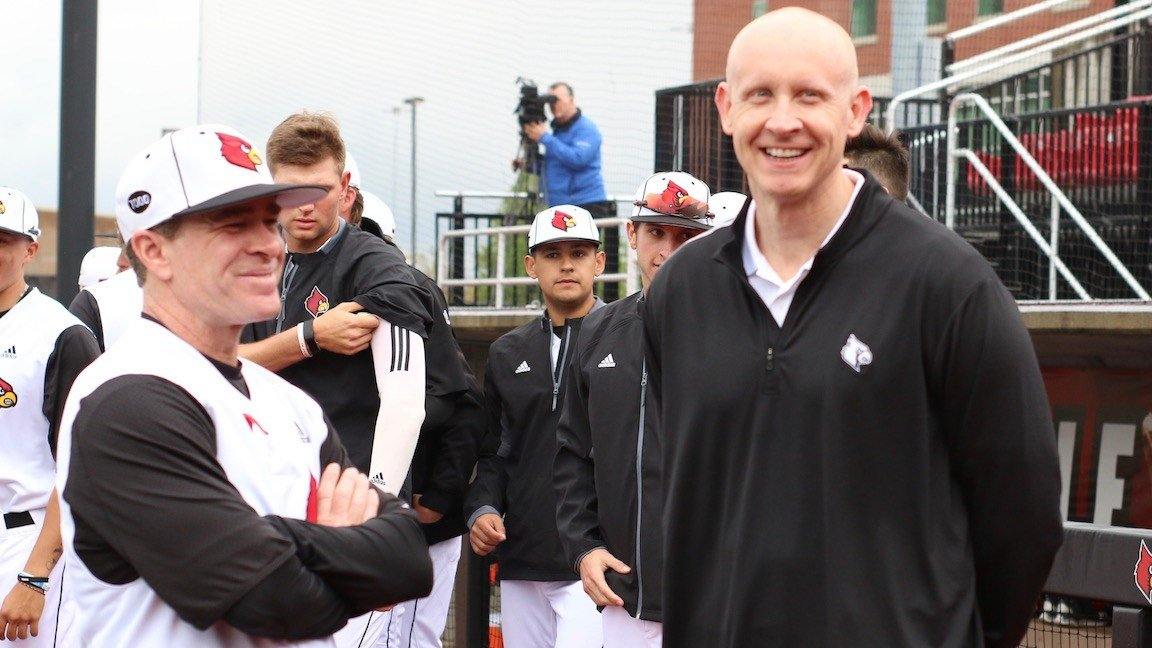 Chris Mack with Louisville baseball coach Dan McDonnell (WDRB photo by Eric Crawford)