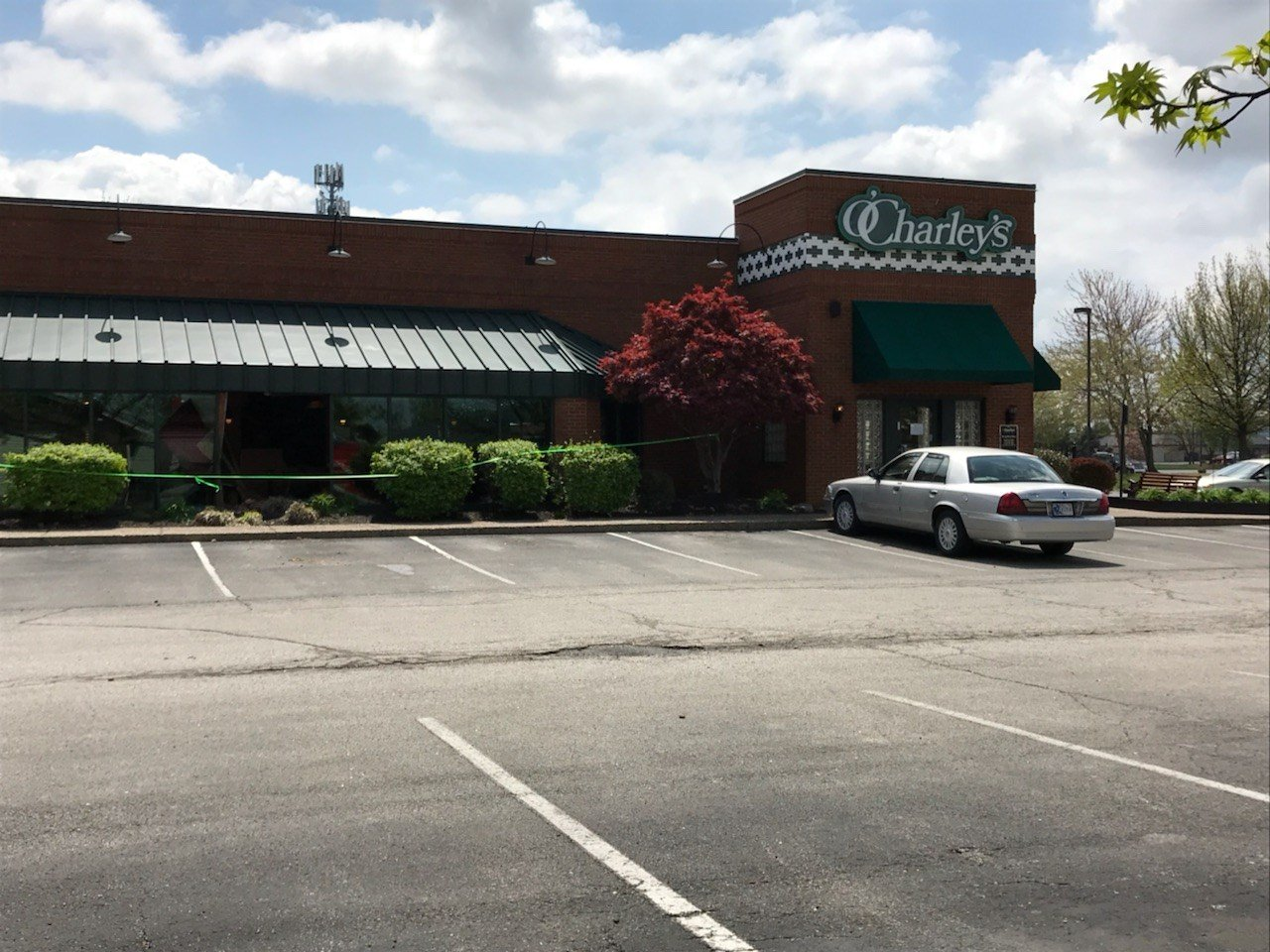 Shattered glass and broken tables and chairs littered the floor of the Clarksville, Indiana, O'Charley's after a car drove into the side of the building, just after 12 p.m.