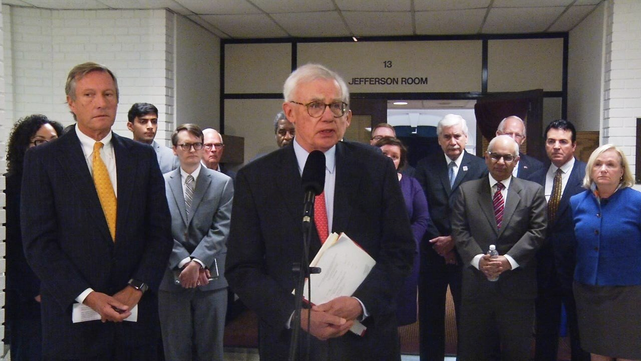 University of Louisville board of trustees chairman David Grissom addresses the media on Wednesday, April 25, 2018, about the university's lawsuit against James Ramsey. Behind Grissom are members of the board of trustees and the U of L Foundation's board.