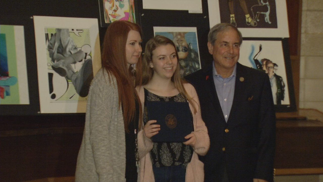 Emily Aycock, a student at Atherton High School, received a surprise visit from Kentucky U.S. Representative John Yarmuth to announce her self-portrait won the annual Congressional Art Competition.