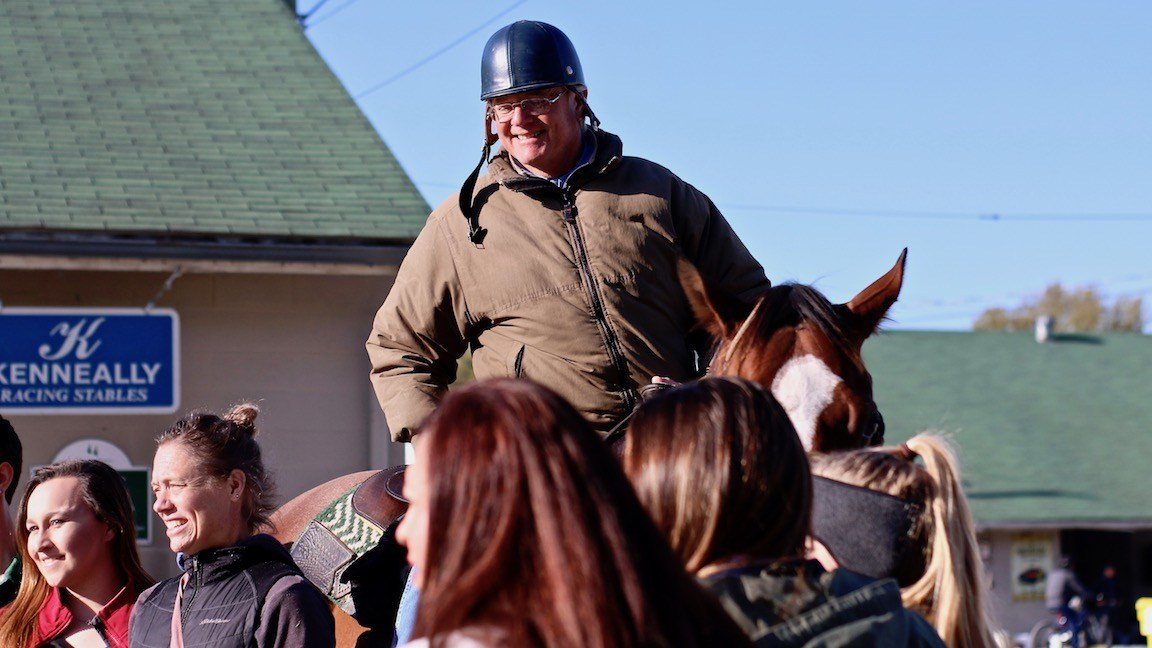 Bill Mott stops to talk with fans on the Churchill Downs backside. (WDRB photo by Eric Crawford)