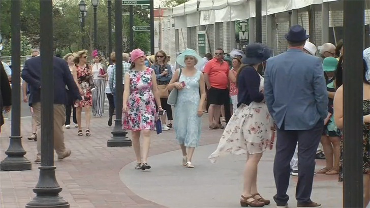 """Thurby"" or Thursday of Derby week brings locals to the track in dresses, suits and hats."