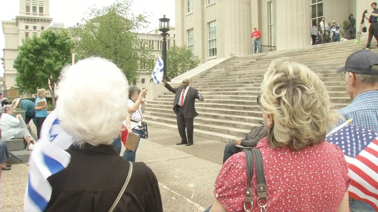 Gatherings were held in downtown New Albany and on the steps of Metro Hall in Louisville.