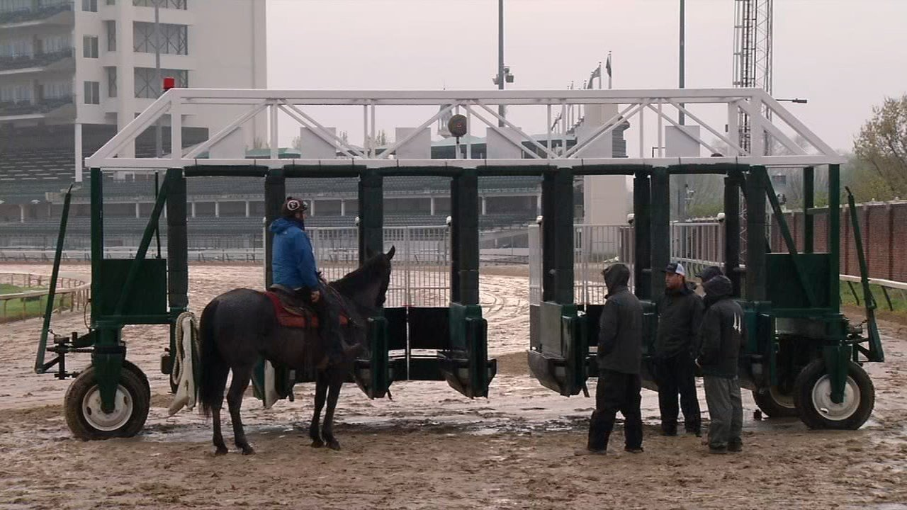 The crew running the starting gate have a dangerous job, and they know the risks of climbing into the gate.