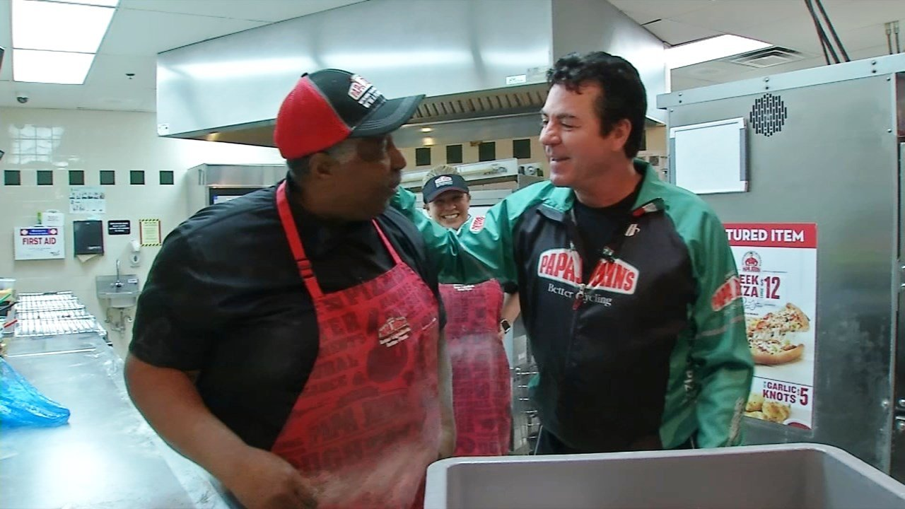 Papa John's International chairman John Schnatter, right, at the restaurant inside the company's Louisville headquarters in June 2017. (WDRB)