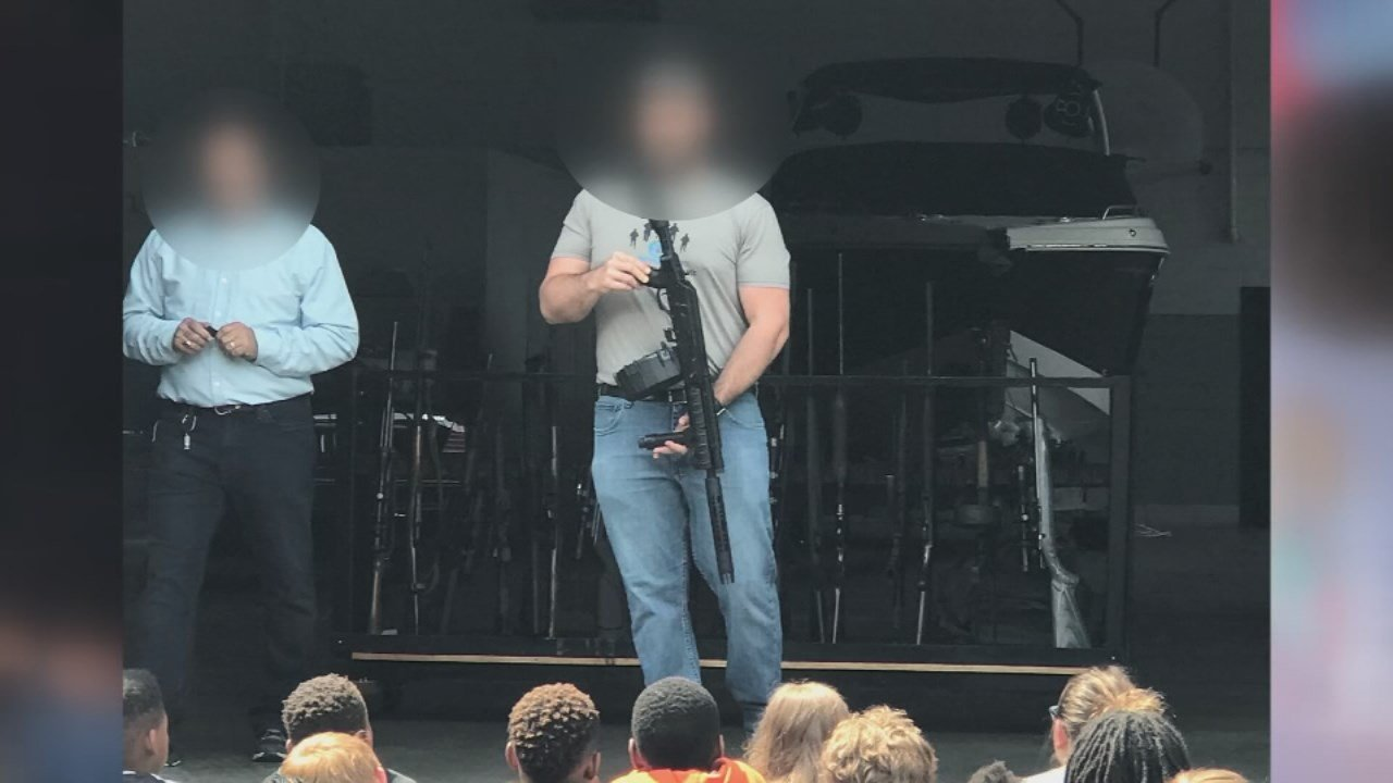 During the field trip, a parent says she and the students were taken to a business where they were being shown guns.