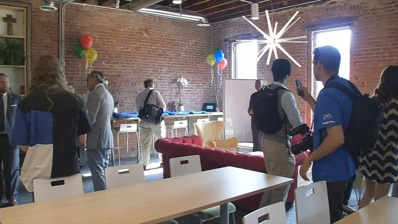 """A ribbon-cutting was held at Love City in the Portland neighborhoodon May 9 for what will be a """"social impact incubator"""" for the neighborhood."""