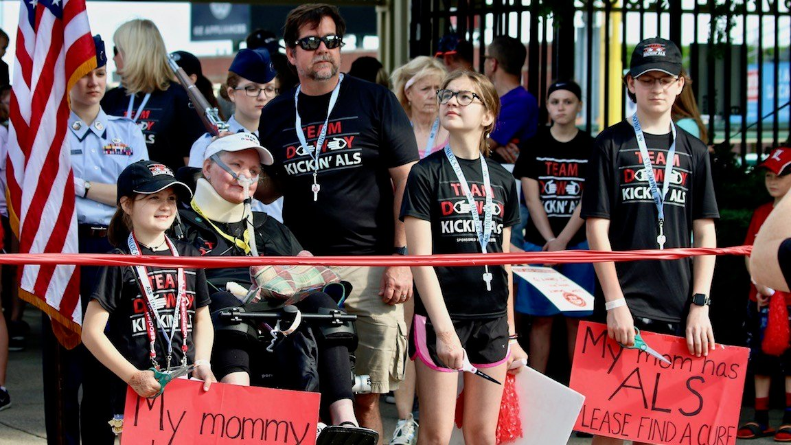 The Dewey family prepares to cut the ribbon to open Saturday's Walk to Defeat ALS (WDRB photo by Eric Crawford)