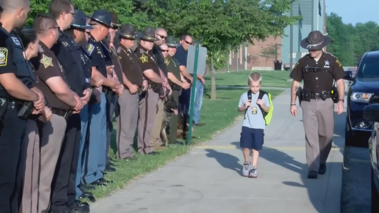5-year-old Dakota Pitt was escorted in to school by police officers supporting his father.