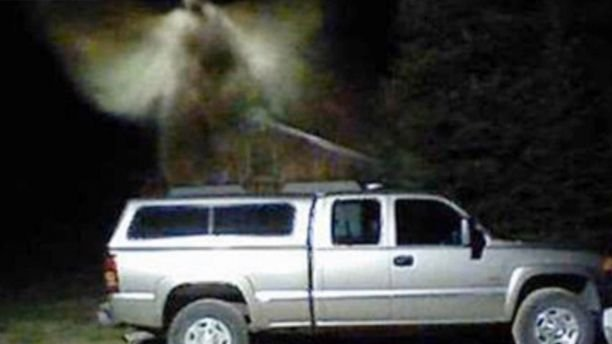 A Michigan man said a security camera capture an image of an angel over his truck.