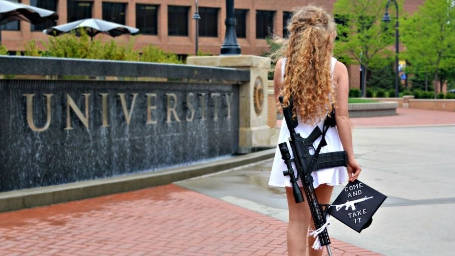 Kent State grad Kaitlin Bennett took photos showing her with a gun and a message for the university.