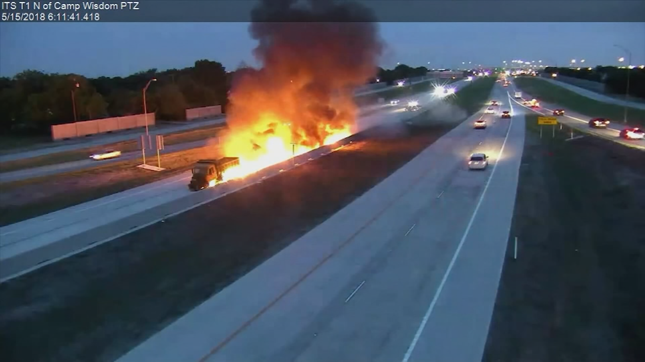 A dump truck burst into flames on a Texas toll road on Tuesday while trying to avoid hitting a car.