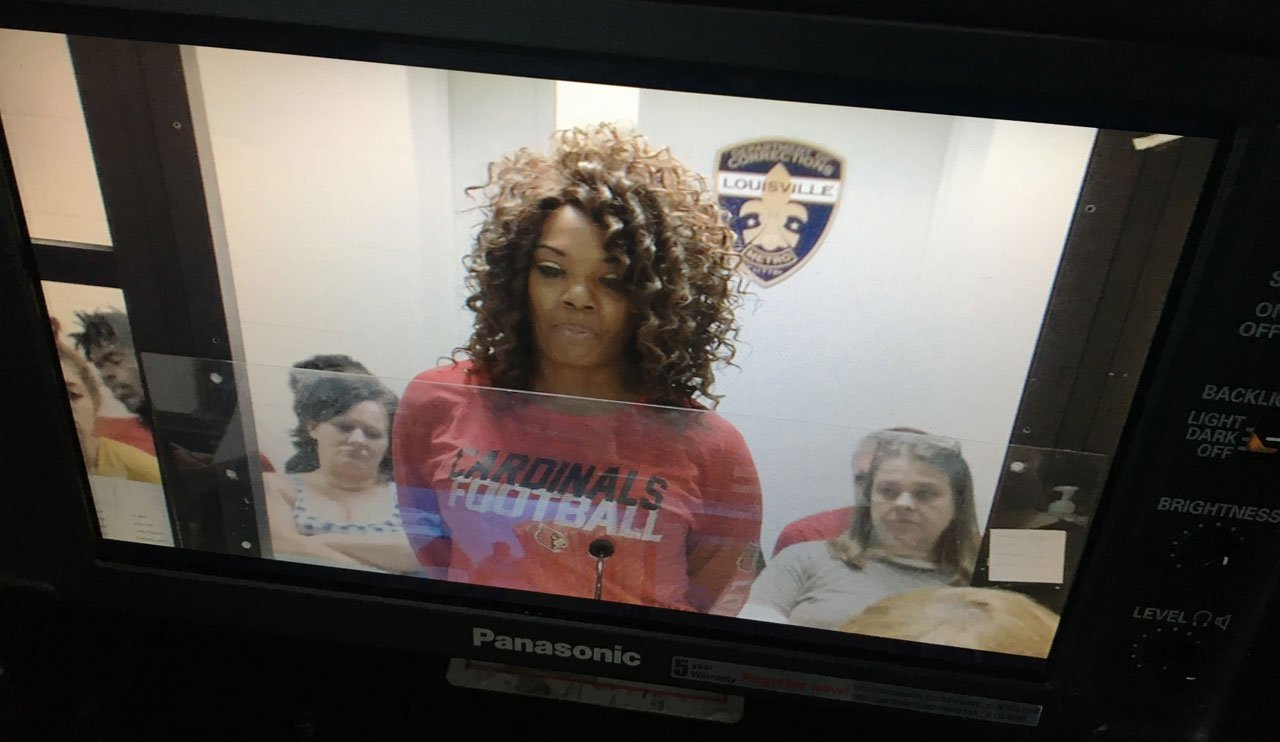 Katina Powell appears before a Jefferson County District judge in a U of L football shirt.