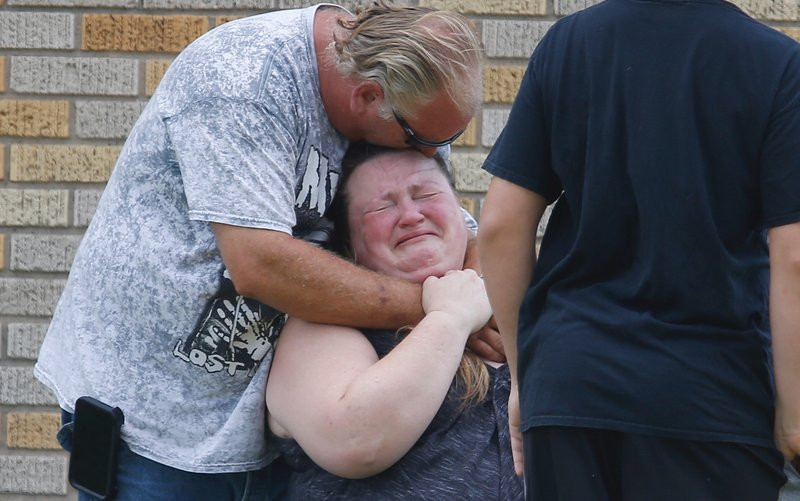 Students being comforted outside the school shooting in Texas.