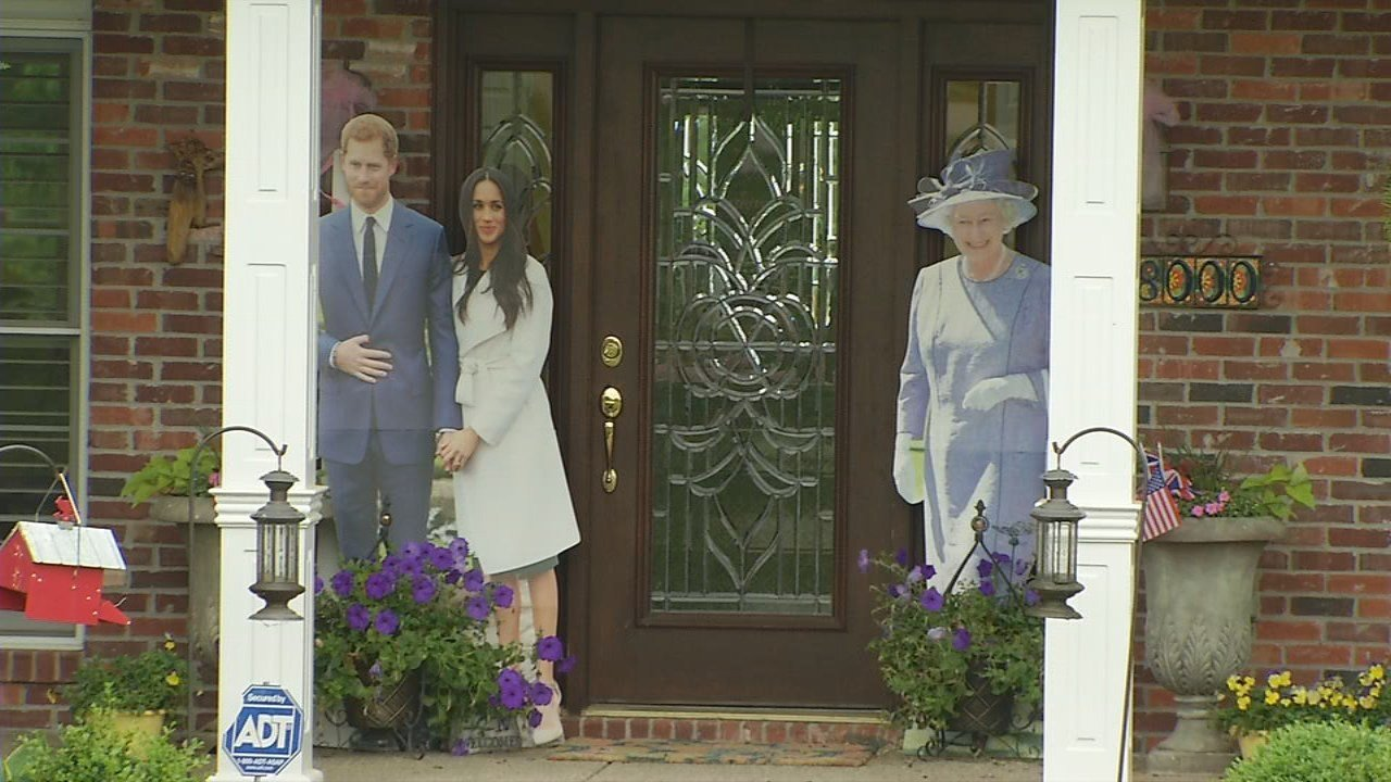 The front porch of Tracy Millican's home is decorated with cardboard cut-outs of Prince Harry, Meghan Markle and Queen Elizabeth.