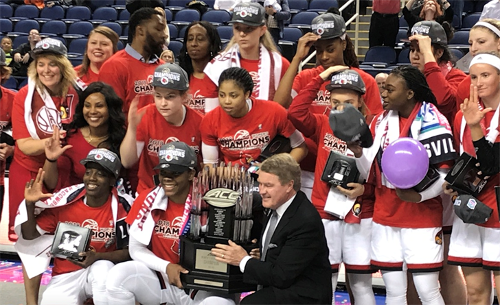 The U of L women's team celebrated their ACC Tournament title with commissioner John Swofford in Greensboro. (Rick Bozich photo)