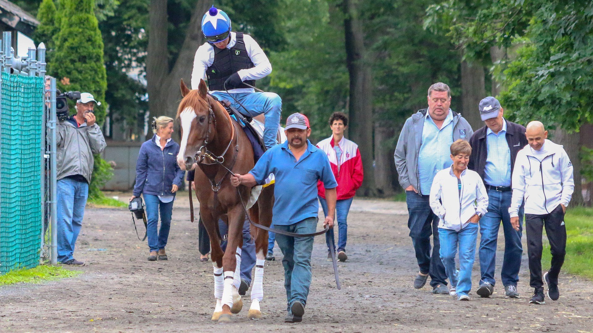 Taking Free Drop Billy to the track Thursday morning, trainer Dale Romans and his wife Tami are at right (WDRB photo by Eric Crawford)