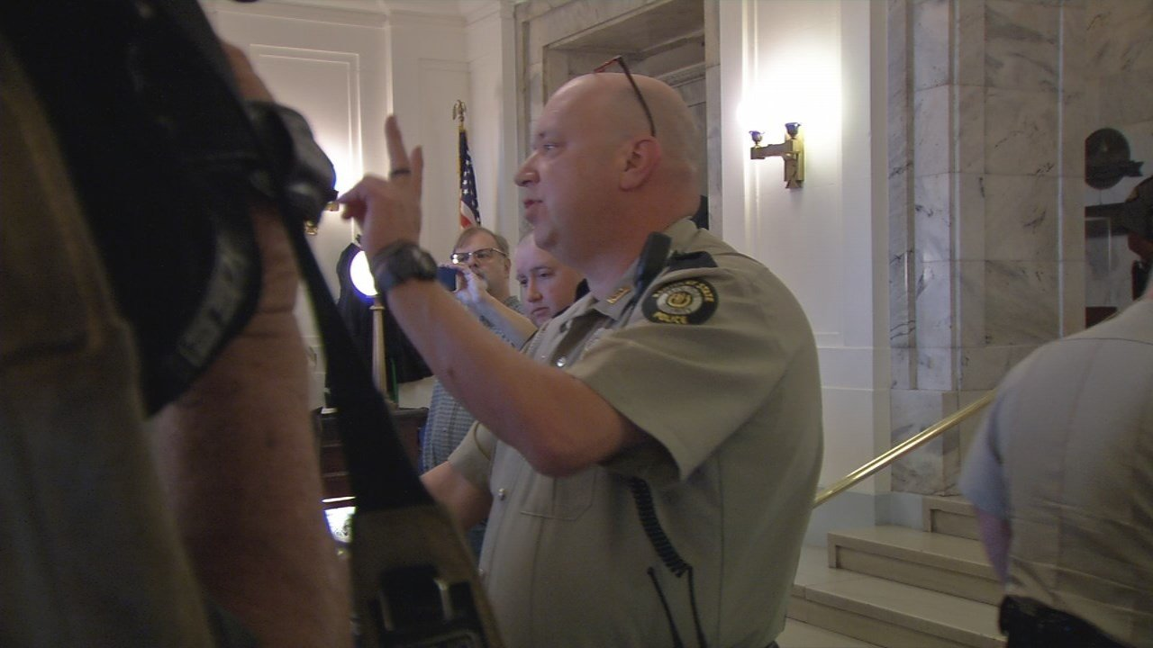 Kentucky State Police tell members of the Poor People's Campaign they can only enter the Capitol two at a time.