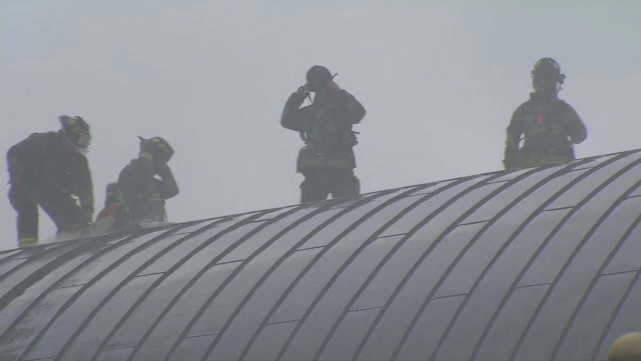 Firefighters worked for hours in the heat and humidity to control the fire at the Kentucky Center.