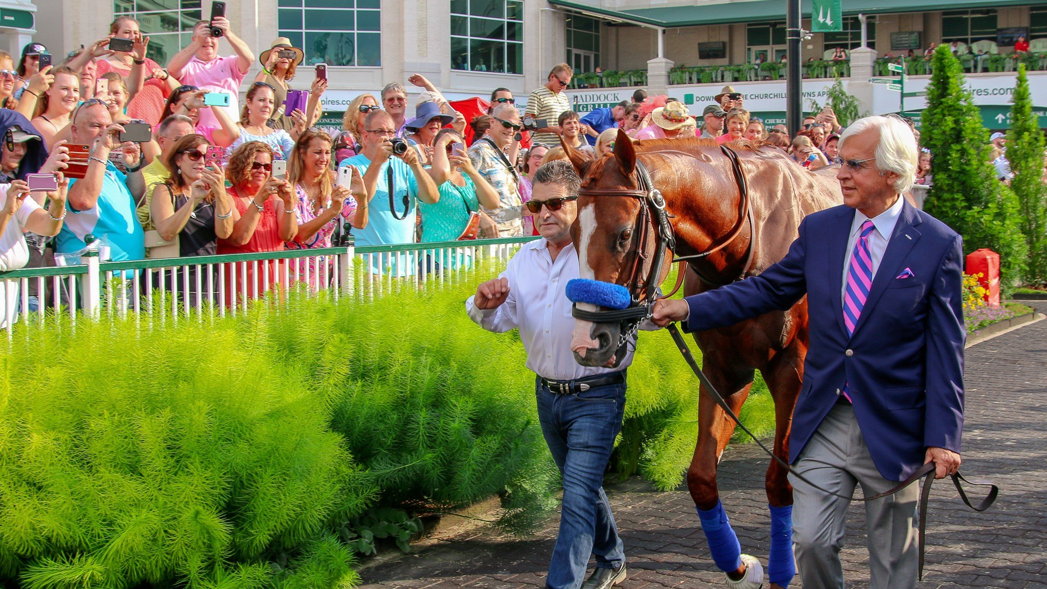 Bob Baffert and assistant Jimmy Barnes walk Justify in the Churchill Downs paddock. (WDRB photo by Eric Crawford)