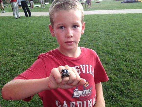 Seth Shinn shows off Chane Behanan's High School All-American ring