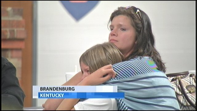 "Tammy Carpenter, Battletown, Ky., hugs her daughter as school board votes to close two schools.  Carpenter says she will miss ""family atmosphere"" at Battletown Elementary."