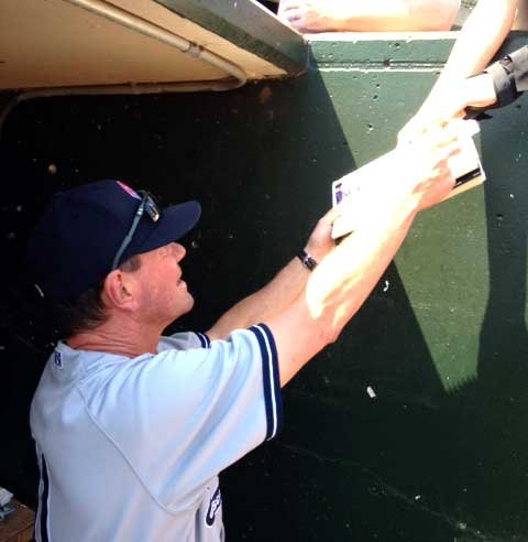 Yankees Manager Butch Wynegar signs autographs at Slugger Field Wednesday.