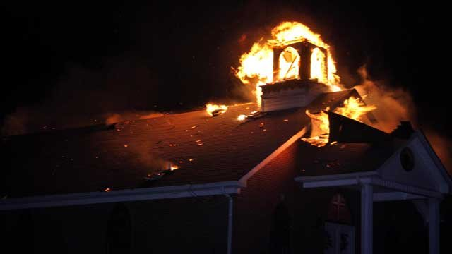 The steeple burns at Summit United Methodist Church in Summit, Ky., Thursday night.  Alanna Wethington/AMW Photography