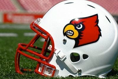 AccuScore.com predicts U of L over UK with a nice game by halfback Dominique Brown.
