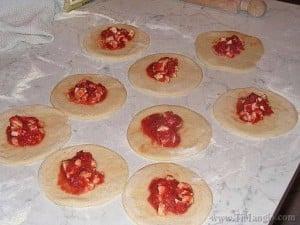 Add a little tomato, mozzorella and filling