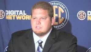 UK offensive lineman Matt Smith says all the pressure is on Louisville Sunday.