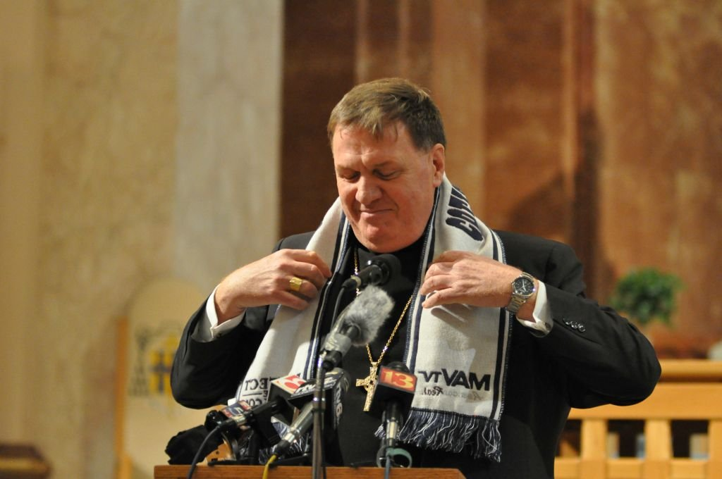 Joseph Tobin, new Indianapolis archbishop, displays Indianapolis Colts scarf at news conference.  Photos from Archdiocese of Indianapolis