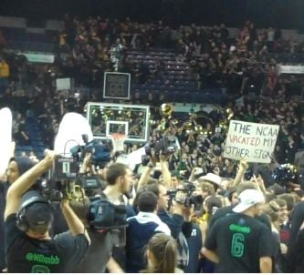 Notre Dame beat Kentucky, 64-50, and then the Fighting Irish students stormed the court.