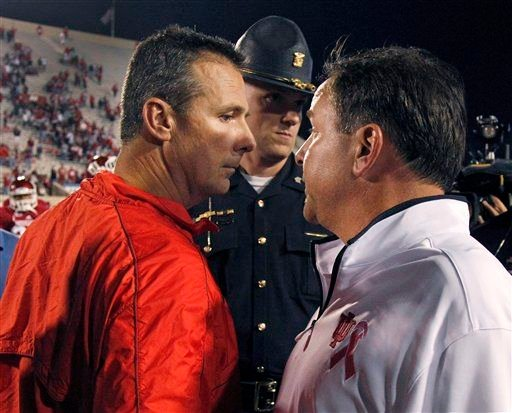 IU football coach Kevin Wilson is going nose-to-nose with the Big Ten's best, including Urban Meyer in recruiting.