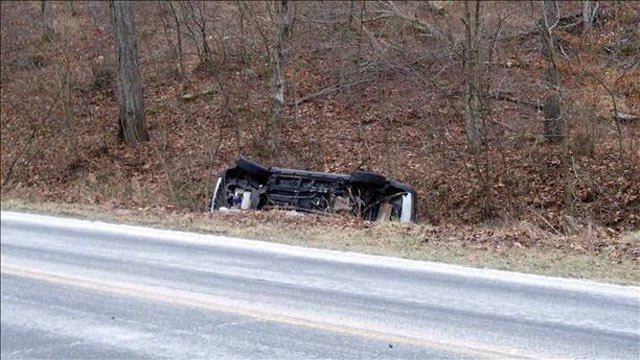 This car overturned in a ditch near Bardstown.