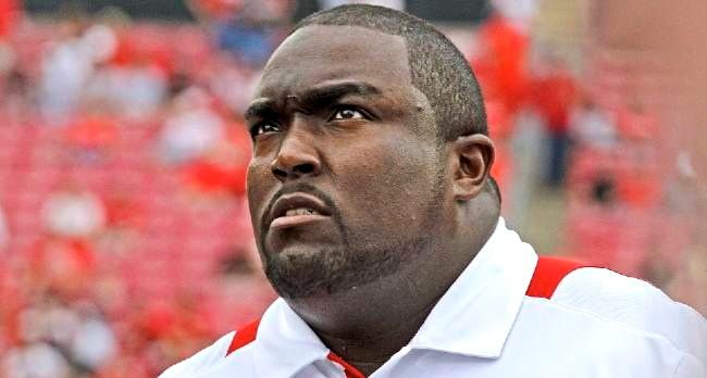 U of L athletic director Tom Jurich remains committed to assistant football coach Clint Hurtt.