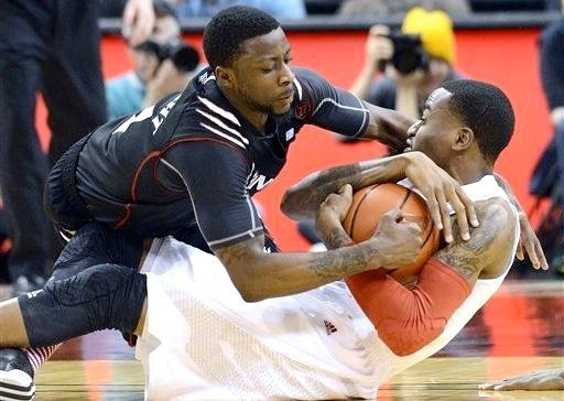 Kevin Ware helped Louisville force 21 turnovers in the Cards' 67-51 win over Cincinnati Monday.