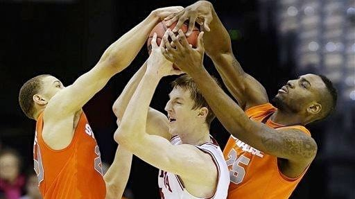 Syracuse surrounded Cody Zeller and his Indiana teammates while defeating the Hoosiers, 61-50.