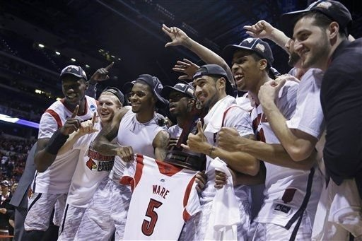 Rallying around injured teammate Kevin Ware, Louisville dominated Duke to win the Midwest Regional and earn a spot in the Final Four.