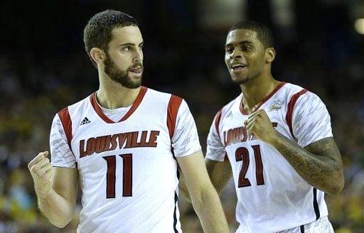 Louisville forward Luke Hancock (11) is enjoying the support of teammates like Chane Behanan as his father battles a serious illness.