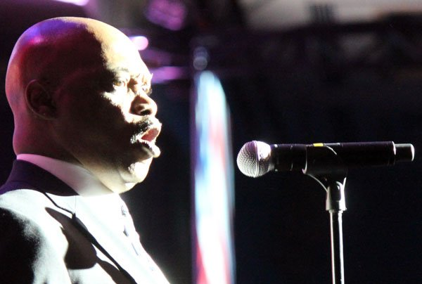 """Dwight Ashley sings the national anthem for attendees of the 2013 Kentucky Derby Festival's """"They're Off!"""" Luncheon."""