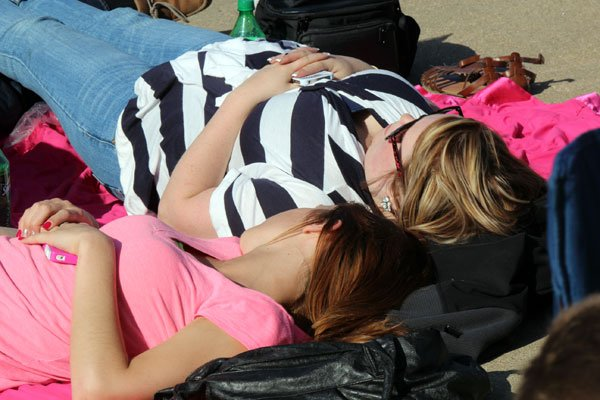 These ladies decided to stretch out and relax as they wait for the Thunder Over Louisville 2013 fireworks to begin!