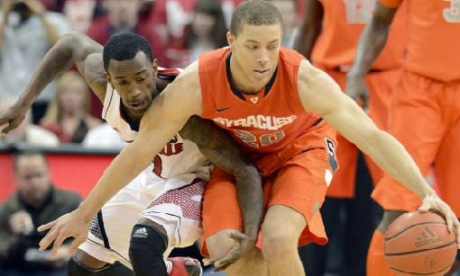 At least one NBA scouts says that Russ Smith should return to Louisville for his senior year to improve his point guard skills.