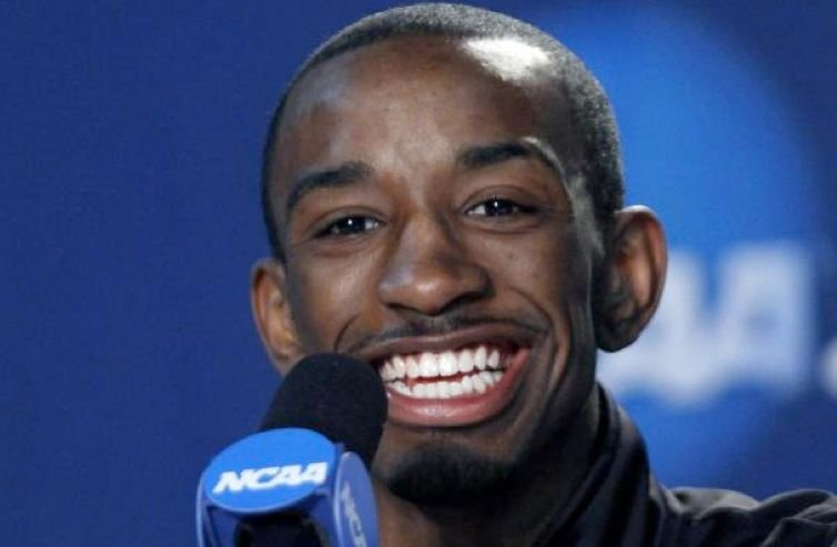 Russ Smith speaks with reporters after the NCAA championship game. Smith will return to Louisville for his senior season.