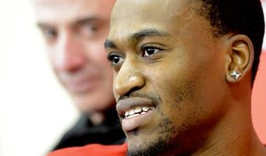 Louisville's Kevin Ware, beside Cardinals coach Rick Pitino, talks with reporters after surgery to repair the broken leg he suffered against Duke. (AP photo)